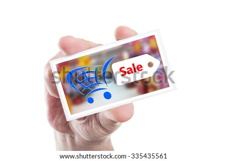 Hand holding shopping sale card as supermarket or hypermarket discount concept