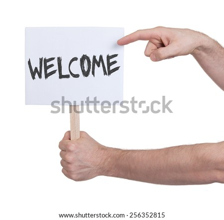 Hand holding sign, isolated on white - Welcome - stock photo