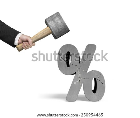 Hand holding sledgehammer hitting cracked percentage sign isolated on white background - stock photo