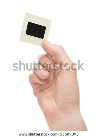 hand holding slide on white background - stock photo
