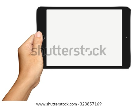 Hand holding Small Black Tablet Computer on white background - stock photo