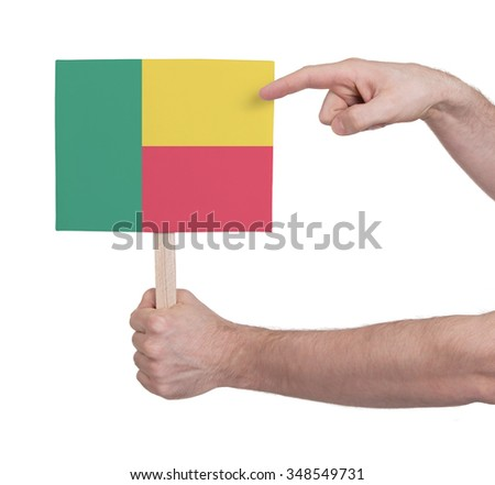 Hand holding small card, isolated on white - Flag of Benin