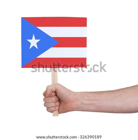 Hand holding small card, isolated on white - Flag of Puerto Rico - stock photo