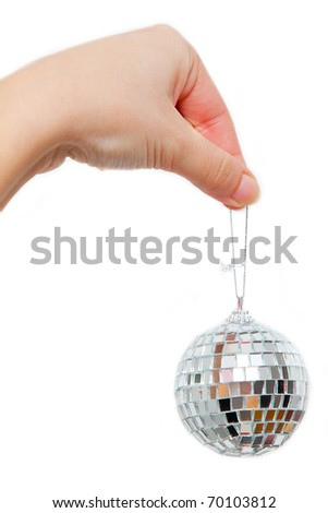 Hand holding small disco ball on string isolated on white background