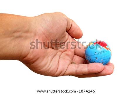 Hand holding small globe over white - stock photo