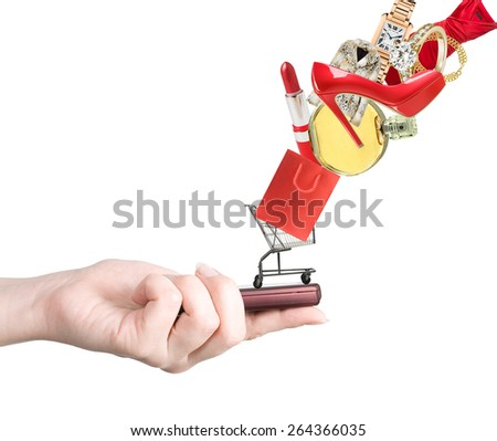 Hand holding smart mobile phone and goods flying away. E-shopping concept. Woman e-shopping concept - stock photo