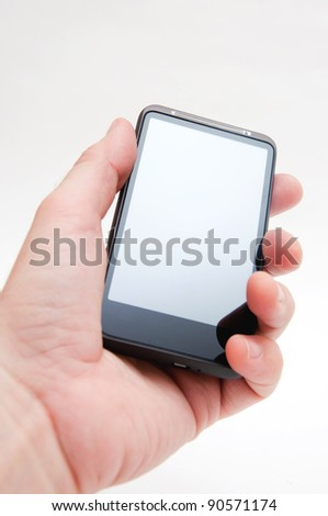 Hand holding smart phone mobile device over a white background. - stock photo