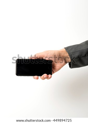 Hand holding smart phone on white background.