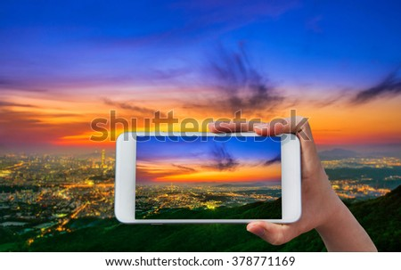 Hand holding smart phone take a photo at South Korea skyline of Seoul, The best view of South Korea.  - stock photo