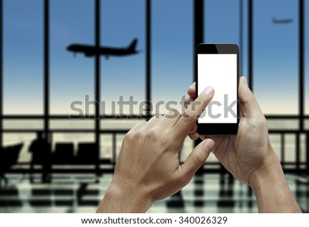Hand holding smart phone with index finger touching the screen - stock photo