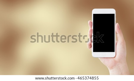 Hand holding smartphone, Abstract color blue background