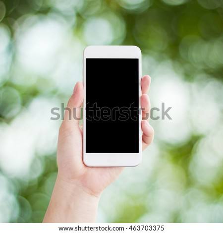 Hand holding smartphone, Abstract color bokeh background