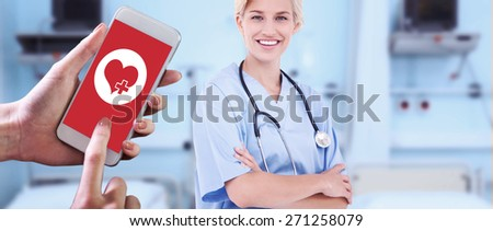 Hand holding smartphone against sterile bedroom - stock photo