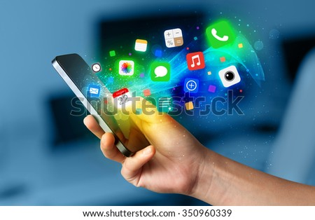 Hand holding smartphone with colorful app icons concept - stock photo
