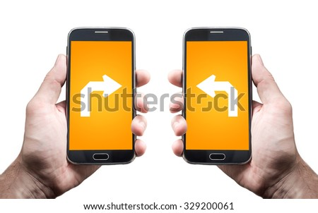 Hand holding smartphone with gps navigation arrow on the screen, left and right - stock photo