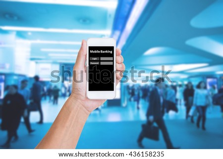 Hand holding smartphone with mobile banking login on screen - stock photo