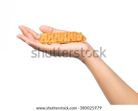 Hand holding snack isolated on white background