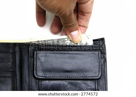 Hand holding some meny in a wallet - stock photo