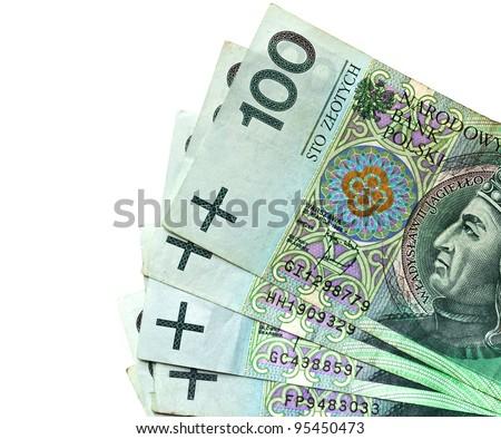 Hand holding stack of hundreds Polish zloty banknotes - stock photo