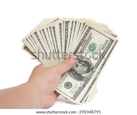 hand holding stacks of 100 USD paper currency on white with clipping path