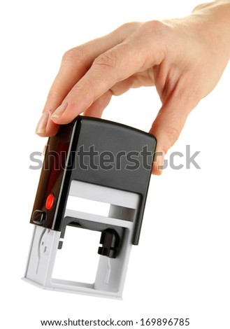 Hand holding stamp isolated on white - stock photo