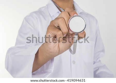 Hand holding stethetoscope on white background