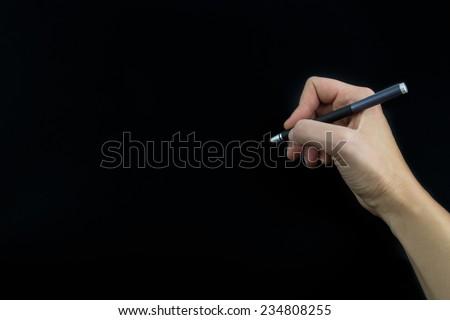 Hand holding stylus isolated on black background - stock photo