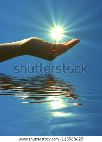 hand holding sun and water reflaction with copyspace - stock photo