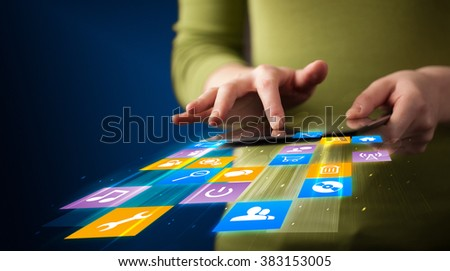 Hand holding tablet device with media application concept on background - stock photo