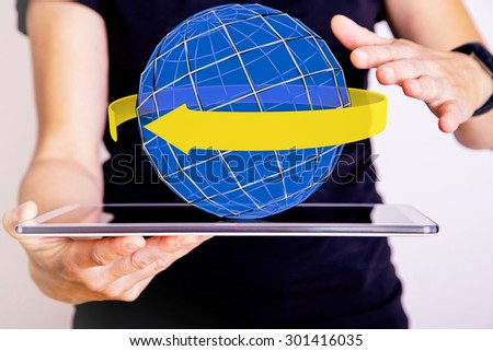 Hand holding tablet pc with sphere and band