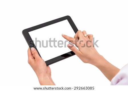 Hand holding tablet pc with touching hand. Isolated on white.