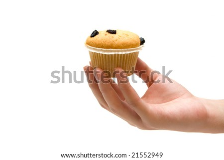 hand holding tasty muffin - stock photo