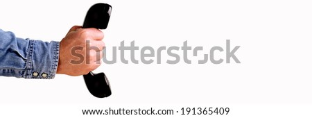 Hand Holding Telephone against a white background - stock photo