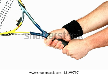 Hand holding tennis racket isolated - stock photo