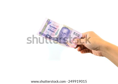 Hand holding Thai money isolated on white. - stock photo