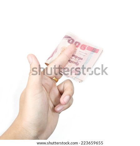 Hand holding thai money isolated on white background. - stock photo