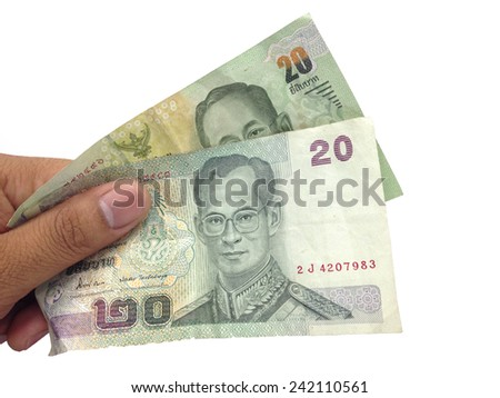Hand holding thai money isolated on white background.