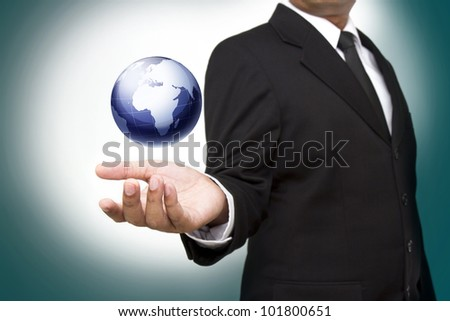 hand holding the business world