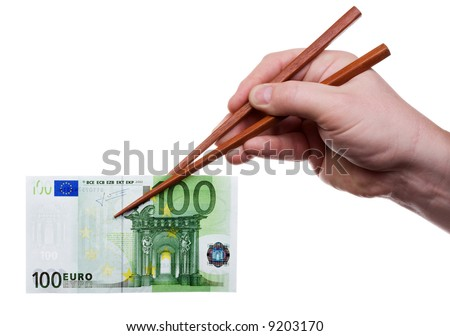 Hand holding the chopsticks with banknote. Isolated on white [with clipping path]. - stock photo