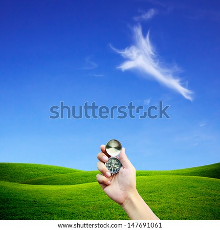 Hand holding the compass. Navigation Concept. - stock photo