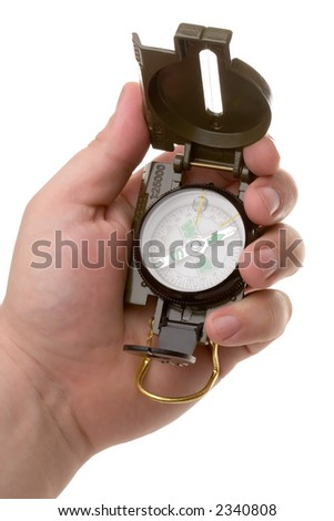 Hand holding the compass on the white background - stock photo