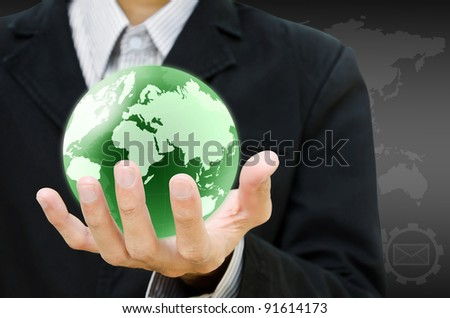 hand holding the earth globe