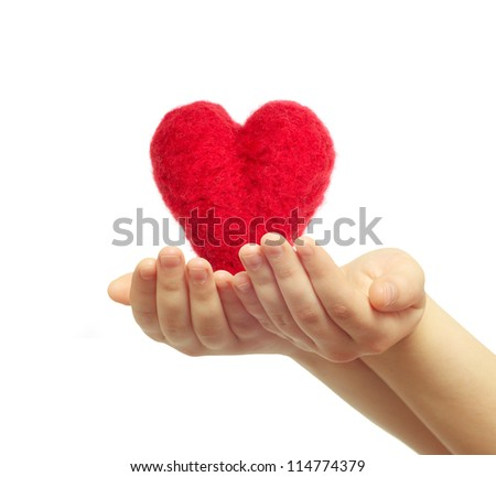 Hand holding the heart isolated on white background