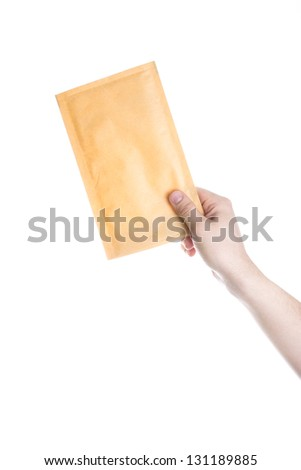 Hand holding the letter isolated on white background - stock photo