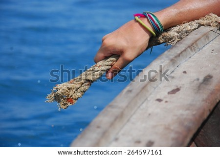 Hand holding the rope