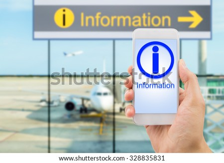 hand holding the smartphone searching information at the lobby airport - stock photo