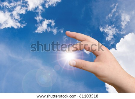 hand holding the sun