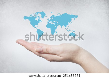 Hand holding the world map. Concept for new technologies and communication  - stock photo