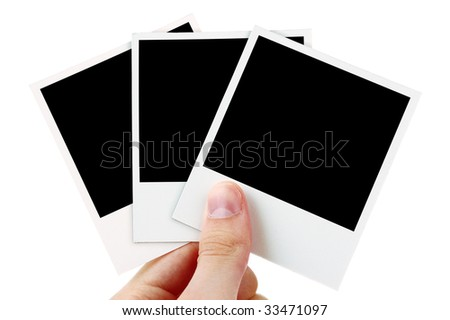 Hand holding three blank photos