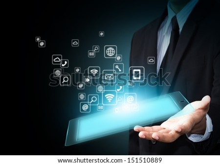 Hand holding touch pad with icons